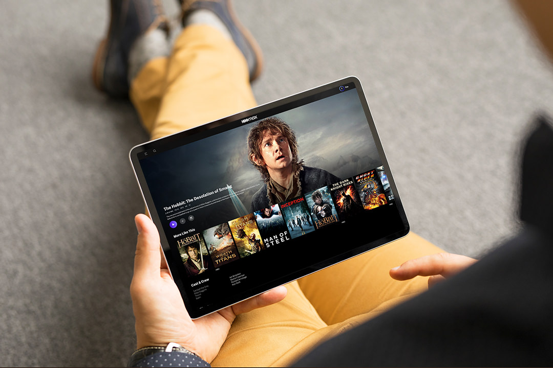 Man looking TV series and movies on his digital tablet